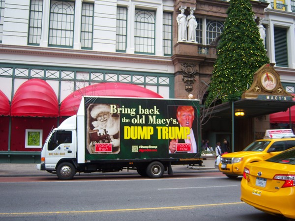 A mobile billboard asks Macy's to dump Trump.