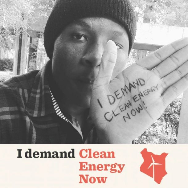 Hand with Demand Clean Energy Now written on it.