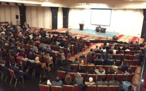 Nisreen Haj Ahmad and Marshall Ganz speak at Ahel event in Jordan, 2018.