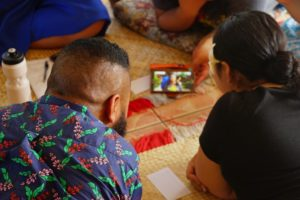 Sharing mobile created content at the Pacific Climate Warrior Retreat.