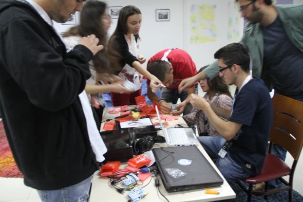 Kosovo youth assemble monitors